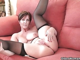 mature amateur British milf Joy exposing her big tits and hot fanny