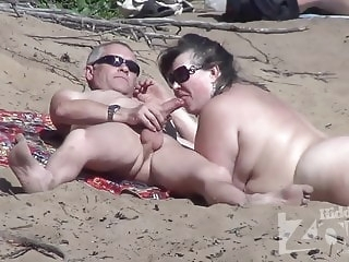 beach amateur Blowjob on a nudist beach.